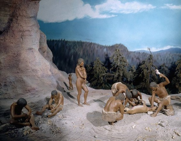 Mexico City, Mexico --- Diorama of prehistoric hunter-gatherers making stone tools and butchering a recent kill. --- Image by © Gianni Dagli Orti/CORBIS